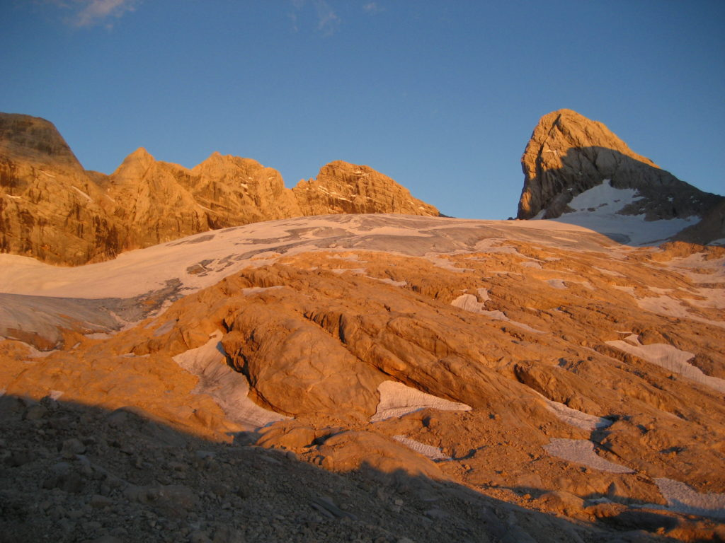 An evening view of Höher Dachstein (in the middle) and Mitterspitz (on the right) with the Obere Windluck'n col in between; photo taken from our bivouac above the Adamekhütte
